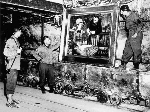 monuments-men-with-painting-in-tunnel